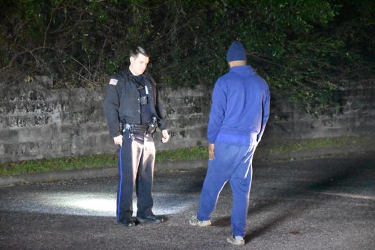 Pensacola Police Department Officer Branden Brown conducts a field sobriety test on Jan. 1.