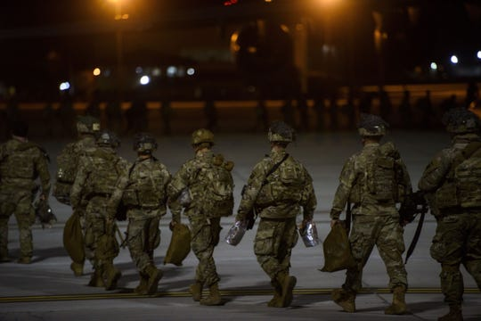 Soldiers board a C-17 aircraft Wednesday, Jan. 1, 2020 at Fort Bragg, N.C., to be deployed in Iraq. (Melissa Sue Gerrits/The Fayetteville Observer via AP)