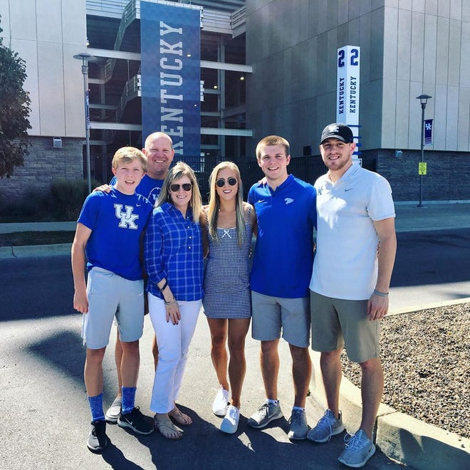 Former York College guard Mike Frauenheim, right, and his family pose for a photo at the University of Kentucky. Frauenheim joined Kentucky as a graduate assistant on the men's basketball coaching staff this season.