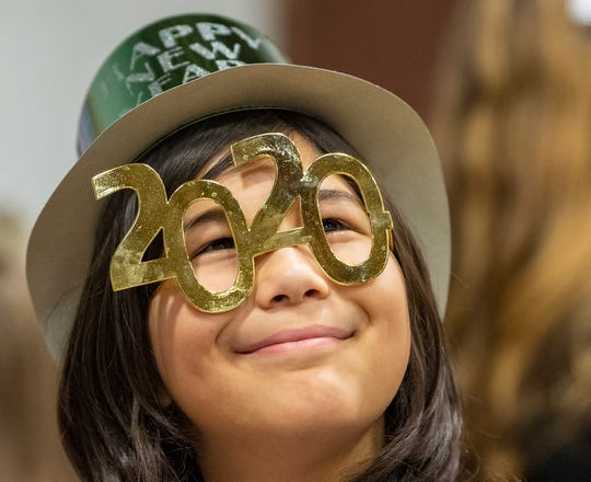 Abhiyan Budhathoki, 10, breaks a smile looking up through his 2020 glasses during the Kids Countdown at Voni Grimes Gym in York.