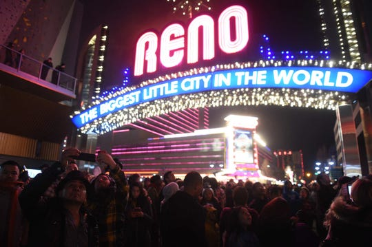 People celebrate the New Year in downtown Reno on Dec. 31, 2019 and Jan. 1 2020.