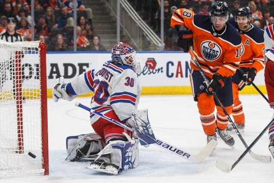 New York Rangers goalie Henrik Lundqvist (30) makes the save on Edmonton Oilers' James Neal (18) during second period NHL hockey action in Edmonton, Alberta, Tuesday, Dec. 31, 2019.