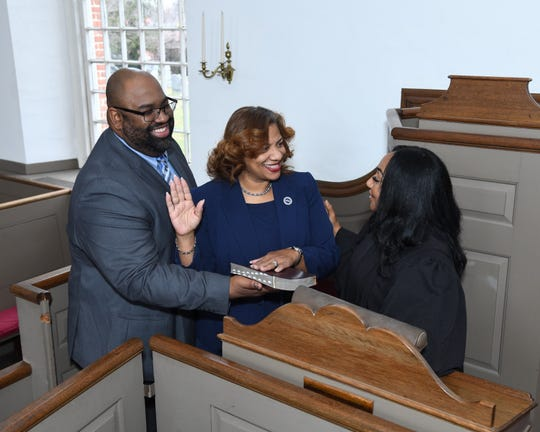 Hours before officially becoming mayor of Mount Vernon, Shawyn Patterson-Howard takes the oath of office on Dec. 31, 2019, from Mount Vernon City Judge Nichelle Johnson as her husband, Marvin Howard, looks on. The swearing-in was at historic St. Paul's Church.