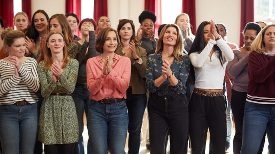 """Kristin Scott Thomas (center left) and Sharon Horgan star in """"Military Wives,"""" a drama about a group of women who form a choir while their partners are serving in Afghanistan."""