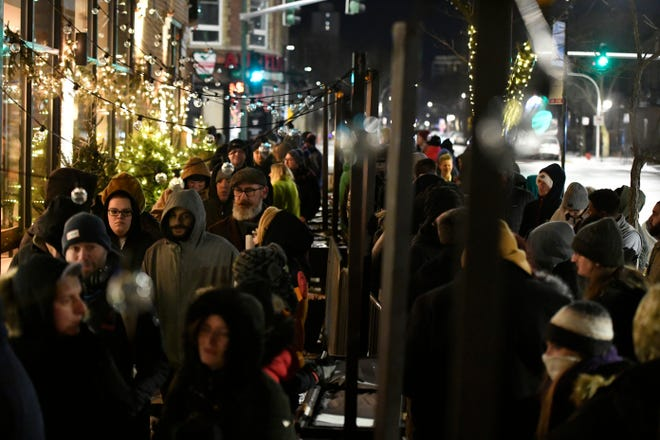 A long line of people brave the cold as they wait to be the first in Illinois to purchase recreational marijuana at Sunnyside dispensary Wednesday, Jan. 1, 2020, in Chicago.
