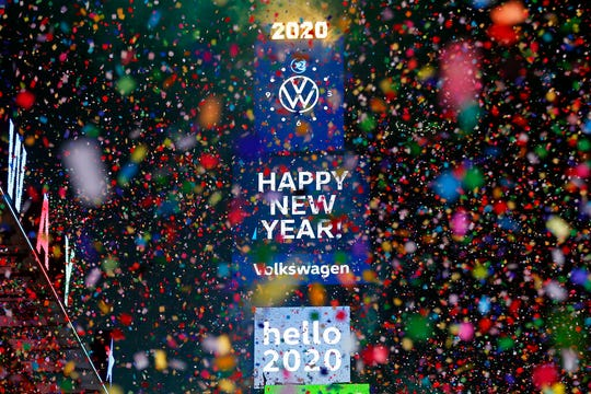 Confetti falls during a New Year's celebration in New York's Times Square, Wednesday, Jan. 1, 2020.