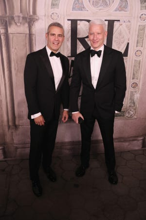 Andy Cohen, left, and Anderson Cooper, seen at a Ralph Lauren fashion show in 2018, shared an awkward, touching and risque moment as they honored Cooper's mother, Gloria Vanderbilt, who died in June, during CNN's New Year's Eve broadcast Tuesday.