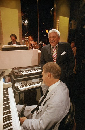 "Trumpeter Jack Sheldon, seen over the right shoulder of host Merv Griffin, standing, performed on the final taping of ""The Merv Griffin Show"" in 1986."