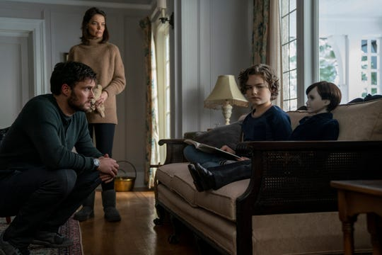 "A young couple (Owain Yeoman and Katie Holmes) are worried when their son (Christopher Convery) makes friends with a strange doll in the horror sequel ""Brahms: The Boy II."""