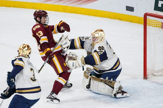 Apr 7, 2018; St. Paul, MN, USA; Notre Dame Fighting Irish goaltender Cale Morris (32) makes a save in the second period against Minnesota-Duluth Bulldogs forward Joey Anderson (13) in the 2018 Frozen Four college hockey national championship game at Xcel Energy Center. Mandatory Credit: Brad Rempel-USA TODAY Sports