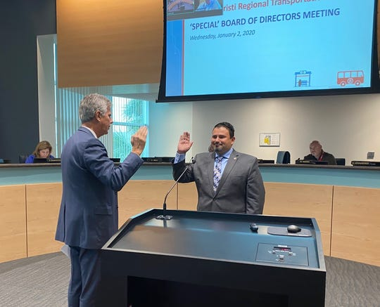 Eddie Martinez, at right, is sworn in as chairman of the Corpus Christi Regional Transportation Authority board.