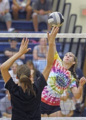 Adena's Jenny Grigsby, right, spikes the ball during a game against Meigs during a volleyball tournament in 2012.