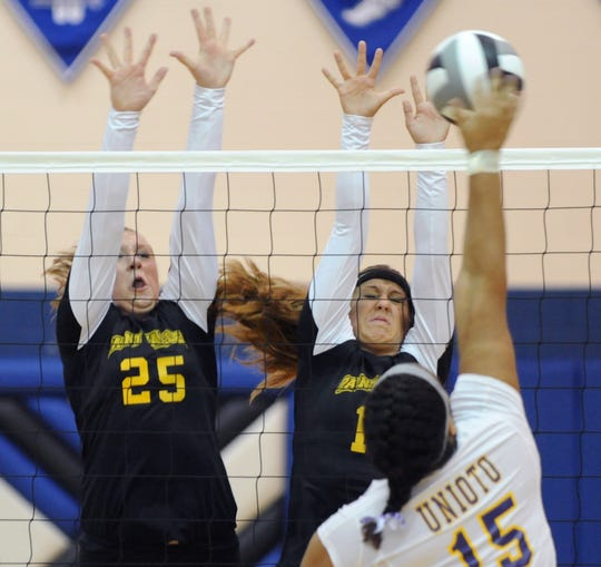 Paint Valley's Taylor Baker (25) and Laci Stanforth attempt to block a spike by Unioto's Skye Brown during their match at the Saturday's Scioto Valley Conference Volleyball Preview in 2012 at Southeastern High School.