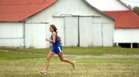 Zane Trace's Taylor Hatfield leads early in the 2009 Down on the Farm cross country race.