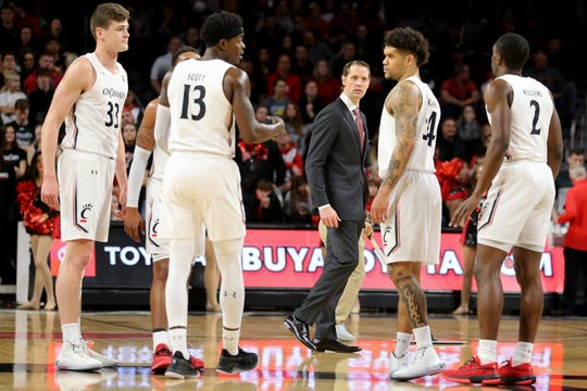 Cincinnati Bearcats head coach John Brannen walks back to the bench after a timeout during the first half of a college basketball game against the Connecticut Huskies, Wednesday, Jan. 1, 2020, at Fifth Third Arena in Cincinnati.