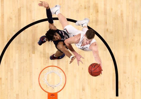 Cincinnati Bearcats center Chris Vogt (33) makes a move to the basket as Connecticut Huskies forward Isaiah Whaley (5) defends during the second half of a college basketball game, Wednesday, Jan. 1, 2020, at Fifth Third Arena in Cincinnati.
