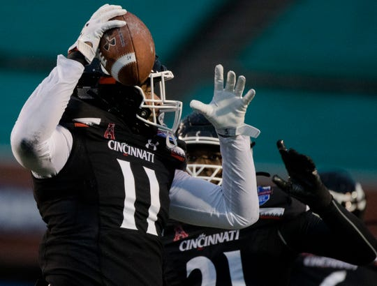 Cincinnati Bearcats tight end Leonard Taylor (11) celebrates after recovering a fumble in the first half of the Birmingham Bowl between Cincinnati Bearcats and Boston College Eagles on Thursday, Jan. 2, 2020, at Legion Field in Birmingham, Ala.