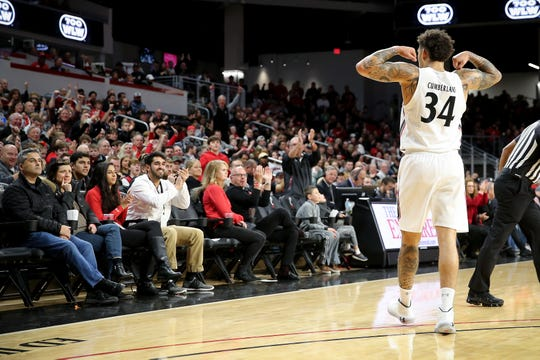 Cincinnati Bearcats guard Jarron Cumberland (34) reacts toward the crowd after scoring a basket and drawing a foul during the first half of a college basketball game against the Connecticut Huskies, Wednesday, Jan. 1, 2020, at Fifth Third Arena in Cincinnati.
