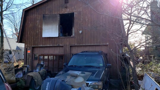 A man died New Year's Day following  fire in the garage of a home in the Fords section of Woodbridge.