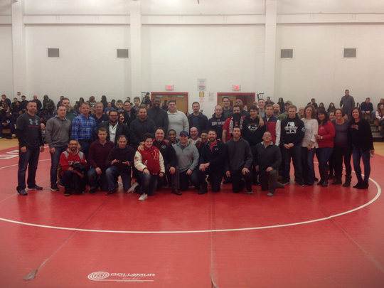 Alumni gather annually to attend the Anthony Raspa Memorial Dual at St. Thomas Aquinas High School