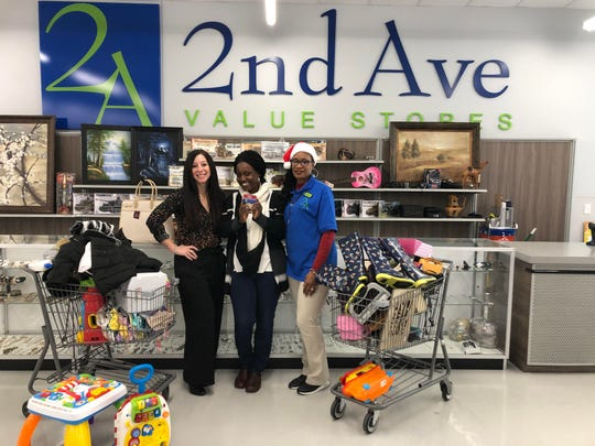 Nicole Rowinski, 2nd Ave merchandise manager; Mariam Marah, a family member chosen from The National Federation of the Blind; and Yvette Young, 2nd Ave retail associate.