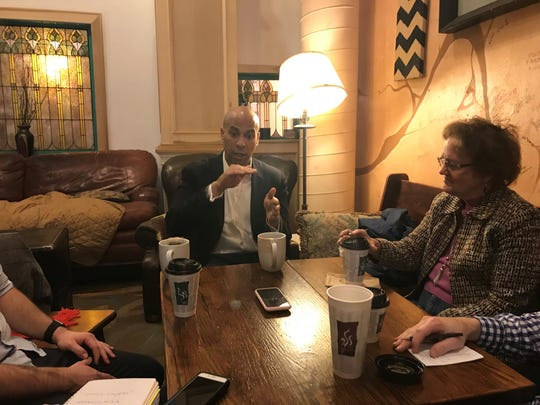 Democratic presidential candidate Cory Booker meets with Des Moines Register reporters and editors on New Year's Day at Des Moines coffee shop Java Joe's.