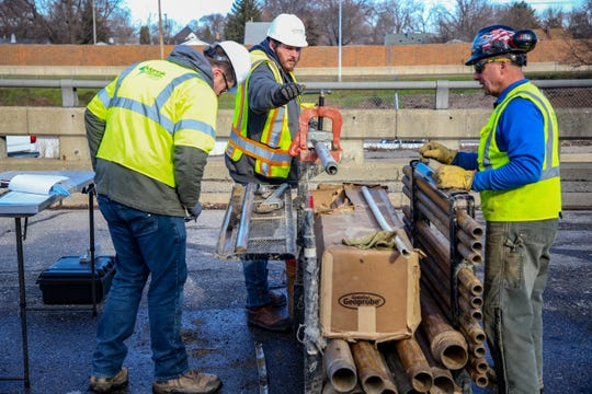 Contractors working with the Environmental Protection Agency and Michigan Department of Environment, Great Lakes and Energy drill for soil samples to better understand the level of contamination at the now closed Electro-Plating Services plant near I-696 freeway in Madison Heights, Mich. photographed on Thursday, Jan. 2, 2020.