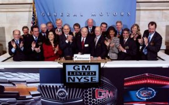 In 2010 General Motors CEO Dan Akerson with company leaders rang the bell at the New York Stock Exchange.