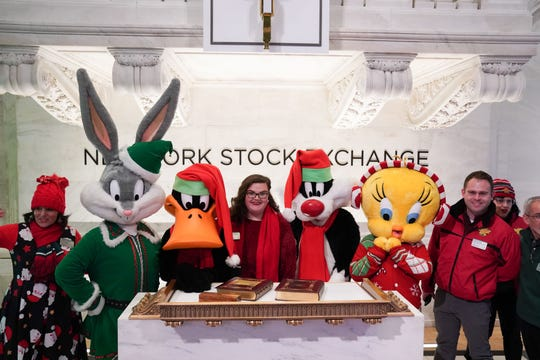Warner Brothers cartoon characters are seen on the floor at the closing bell of the Dow Industrial Average at the New York Stock Exchange on December 5, 2019, in New York.