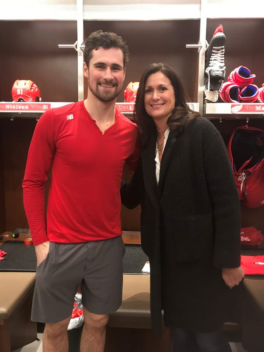 Red Wings forward Dylan Larkin, left, and his mother, Denise, in the Little Caesars Arena dressing room on Thursday, Jan. 2, 2020.