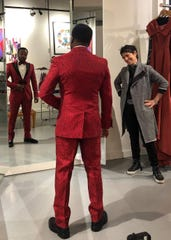 Singer Anthony Hamilton, left, gets fitted at Dolce Moda with owner Jenny Ouliguian.