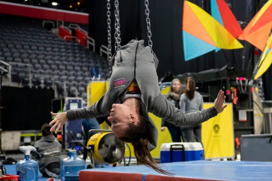 Aerial circus artist Noemie Beauchamp practices her routine backstage during a rehearsal for the Cirque du Soleil performance of Axel, at Little Caesars Arena.