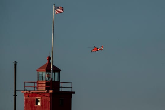 A U.S. Coast Guard helicopter helps in the search for Eliza Trainer on Thursday. Authorities say the teen is missing and presumed drowned after apparently being swept into the water by a large wave around 11:30 p.m. Wednesday