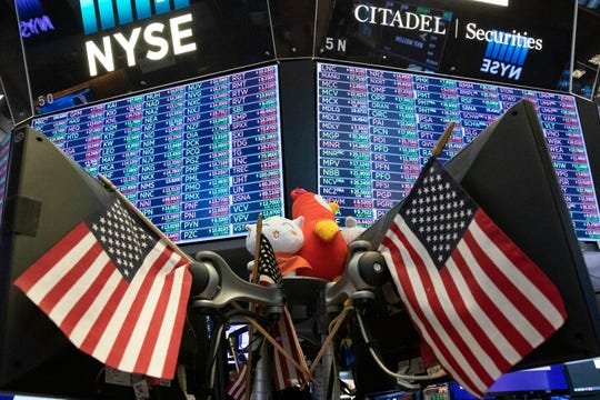 FILE - In this Sept. 18, 2019, file photo, stock prices are displayed at the New York Stock Exchange.