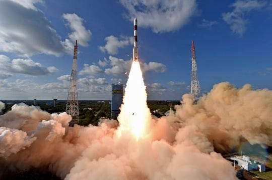 This handout photo provided by the Indian Space Research Organization shows PSLV-C48 lifting off at the Satish Dhawan Space Center in Sriharikota, India, Wednesday, Dec. 11, 2019.