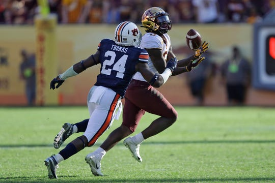 Minnesota wide receiver Tyler Johnson makes a catch after getting around Auburn defensive back Daniel Thomas during the second half.