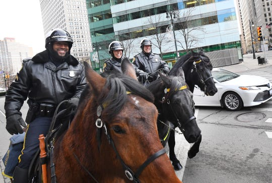 Detroit Mounted Police officers, (from left) Cpl. Garnette Steen riding Capone, Cpl. Sandra Chavez riding Mirah and Cpl Mark Zajac on Remi, patrol near Campus Martius in downtown Detroit Thursday.