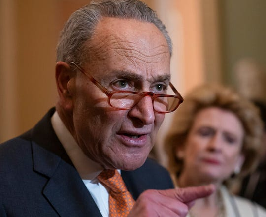 Senate Minority Leader Chuck Schumer, D-N.Y., speaks to reporters at the Capitol in Washington, Tuesday, Dec. 17, 2019.
