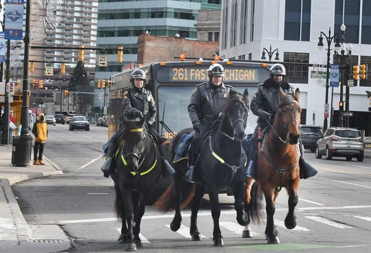 Detroit Mounted Police (from left) Cpl. Sandra Chavez riding Mirah, Cpl. Mark Zajac on Remi and Cpl. Garnette Steen riding Capone patrol the downtown Detroit streets near Campus Martius Thursday.