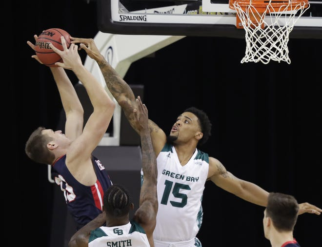 UWGB forward Manny Patterson (15) is averaging 12.8 points and 8.8 rebounds in his last five games.