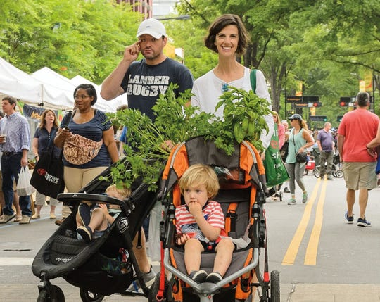 Mason (front) and his mother Jennifer Walton strolling through the TD Saturday Market in downtown Greenville.
