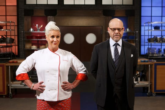 """Worst Cooks in America"" hosts, chefs Anne Burrell and Alton Brown."