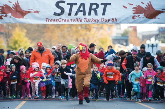 Young runners take off in the TreesGreenville Turkey Day tot trot.
