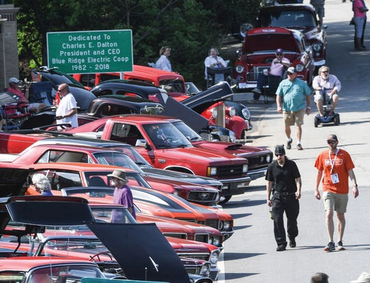 Visitors look at some of the 500 cars on display at the Blue Ridge Fest classic car cruise-in.