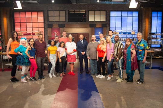 Hosts Anne Burrell and Alton Brown with contestants Alexandra Tiso, Curtis Long, Dakota Klaes, Jolynn Singh, Jefferson Goldie, Joe Deese, Kelly Ngoc Mac, Leo Lech, Kevin So, Leslie Rivera-Silva, Lulu Boykin, Michael Jones-Better, Monica Colwell, Ryan Grovey, Shannon Akins, and Bridget Praytor, as seen on Worst Cooks In America, Season 18.