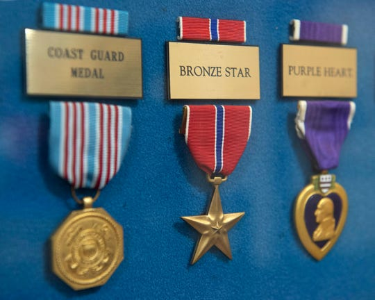 Jerry Holliman earned two Bronze Stars like this one, which hangs in a display showcasing various U.S. service medals at G. V. Sonny Montgomery VA Medical Center in Jackson, Miss. The Bronze Star Medal is a decoration awarded to members of the United States Armed Forces for either achievement, merit or valor in a combat zone.