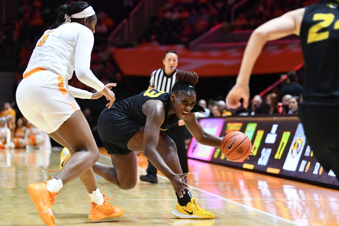 Missouri's Aijha Blackwell (33) saves the ball from going out of bounds during a Southeastern Conference game against Tennessee on Jan. 2 at Thompson-Boling Arena in Knoxville, Tenn.