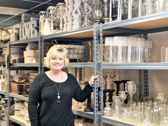 Kristy Myers, certified wedding specialist and founder of Margaret Claire Weddings & Events, in her showroom at 4660 Old Broadway. In less than two years she has outgrown the 2,000 square feet and is set to break ground on a larger 6,000-square-foot location of her own.