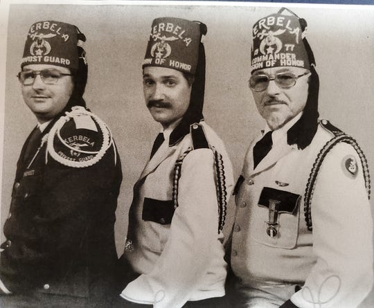 """Brothers Glen, nicknamed """"Butch,"""" and Bob, with their dad Bill, Kerbela Temple Shriners' Commander of the Legion of Honor. 1977."""