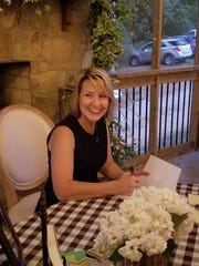 """Author Kelley Griffin signing copies of """"Entangling"""" at an event Oct. 4, 2019, at Estate of Grace Farms in Corryton."""